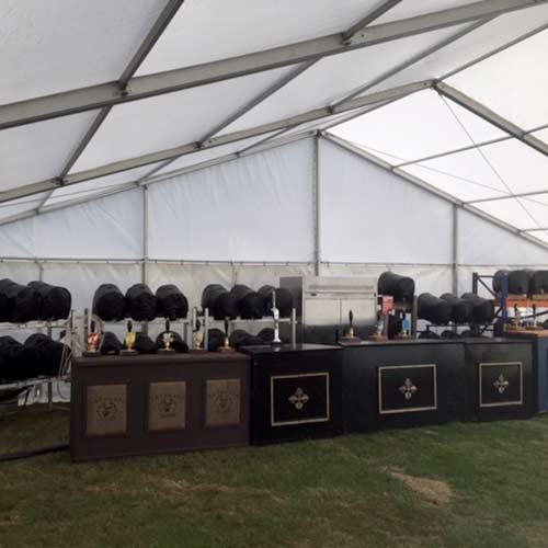 A beer festival tent with a stack of beer kegs we supplied