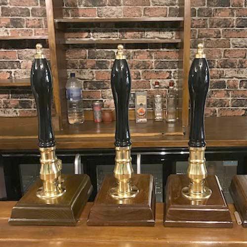 Three ale pumps on a bar