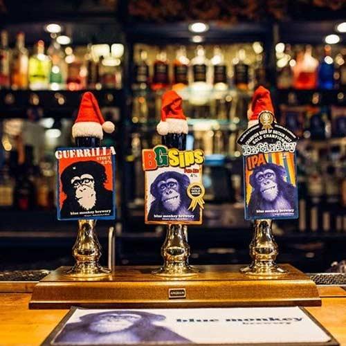Three ale ale pumps on a bar