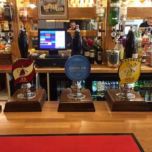 Three pump taps in a pub